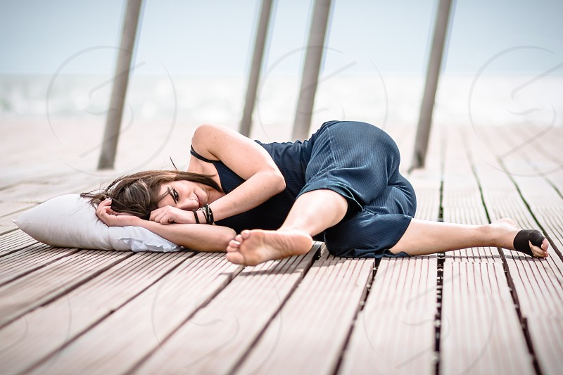 Young Female Dancer Lying On The Dock photo