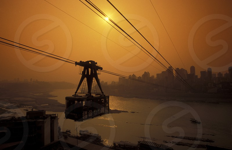 the cable car on the way over the yangzee River in the city of Chongqing in the province of Sichuan in china in east asia.  photo