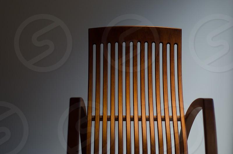 brown wooden armchair photo