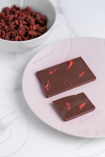 Handmade raw organic goji berry chocolate photo