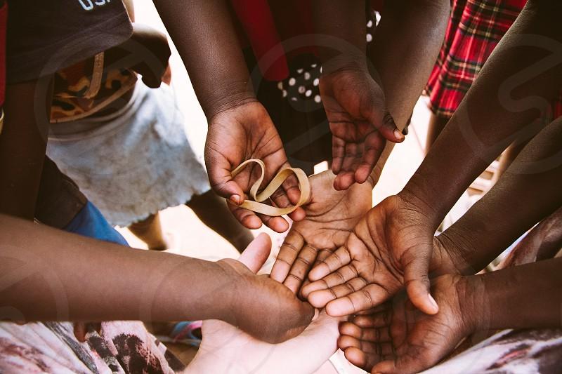 black hands diversity ethnic ethnicity hands hand love kindness kid kids friends family africa uganda  photo