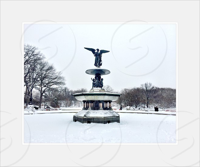 snow covered angel fountain photo