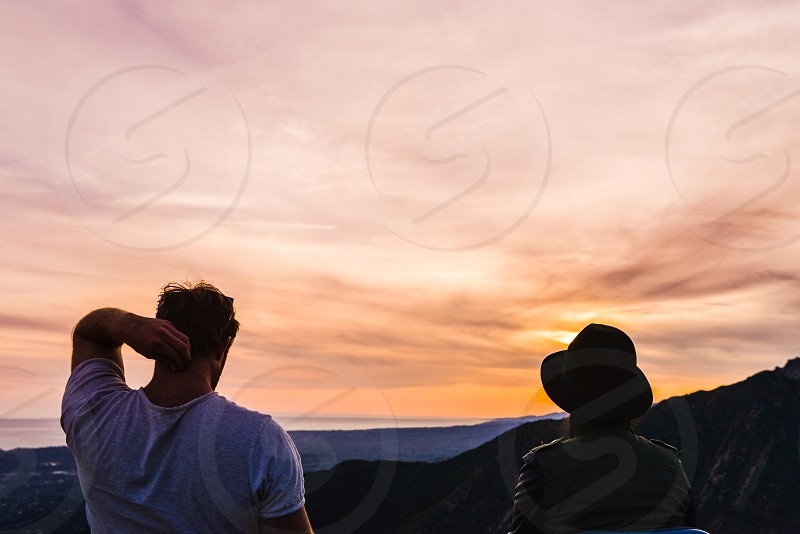 sunset camp sit mountains private romantic nature outdoors lookout couple photo