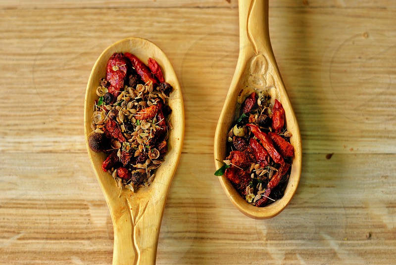 top view photography of dried chili on brown wooden ladle photo