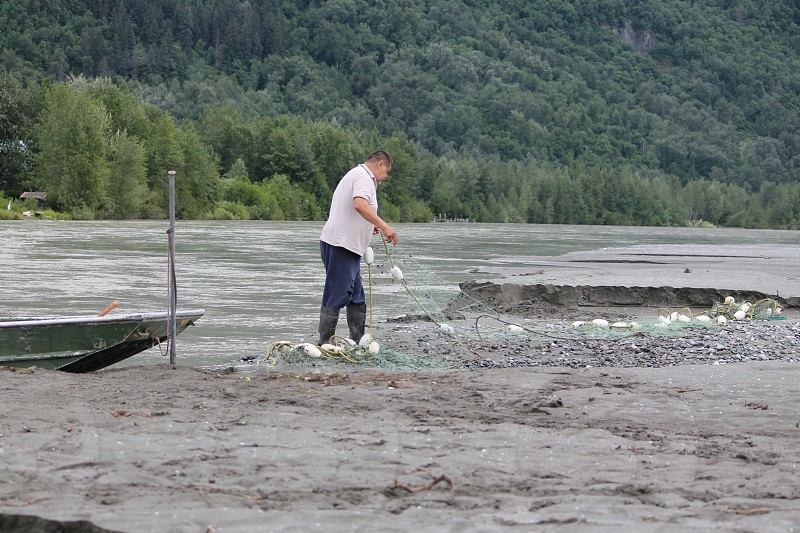 Fisherman getting ready Chilkat River Alaska photo