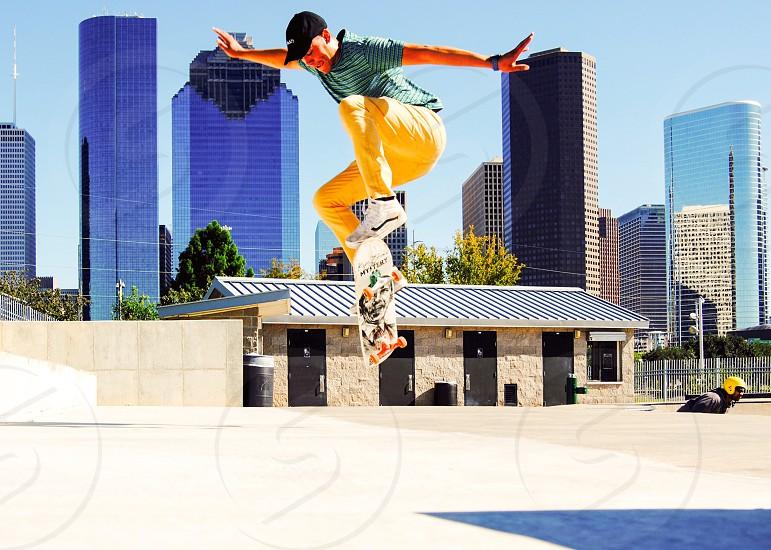 Skateboardskatingoutdoorsoutsidefitnessforjump extremeairskylinecityHouston Texasbuildingskatermaleflysportsactivelifestyleexercisecardiofashionyouthculturehipvansguessforever21mysteryactionshotteenfunadventure photo