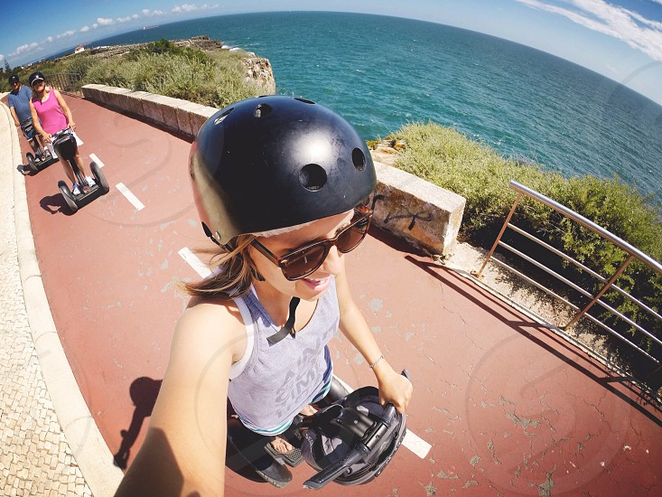 woman wearing black helmet riding black segway photo