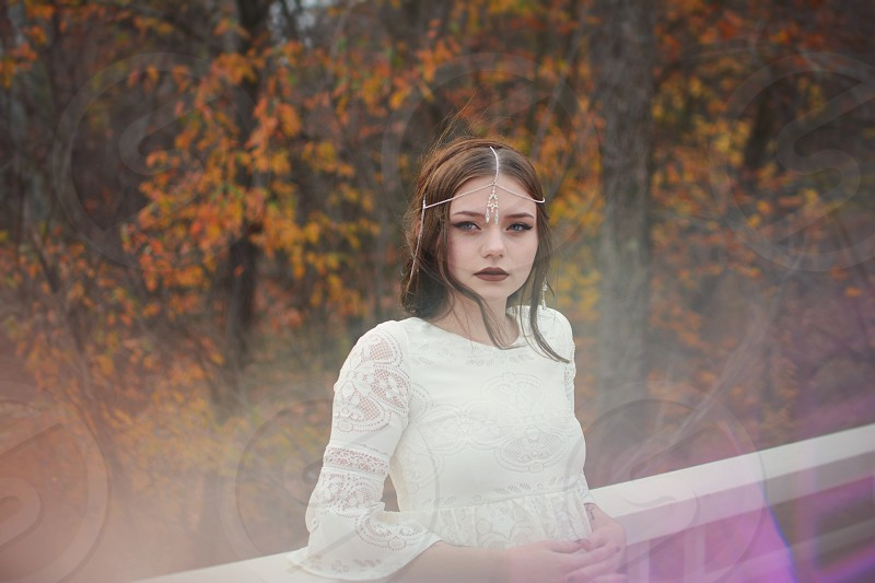 girl in white dress in fall forest  photo