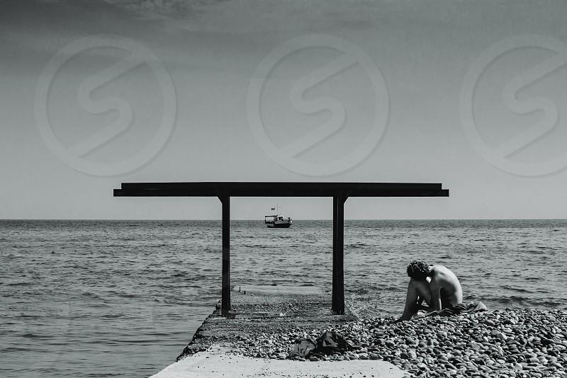 sea loneliness monochrome sky pebbles ship construction photo