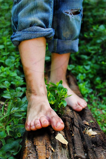 Feet foot walking path railroad tie wood woods brown green blue child children play playing toe toes pants jeans nails leaves nature wild wildlife flora  photo