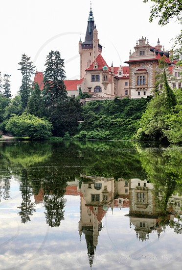 Mirror reflection castle  lake park water nature historical place  photo