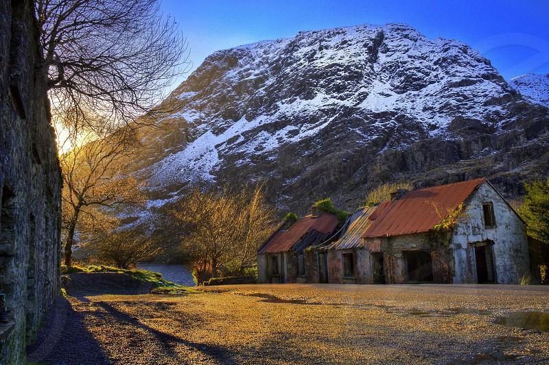 Abandoned cottage at winter sunrise photo