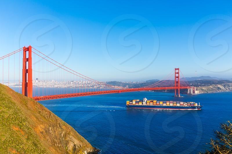San Francisco Golden Gate Bridge merchant ship in California USA photo