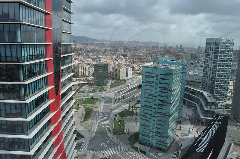 Top view from the window of the skyscraper on Barcelona city. Cloudy weather. photo
