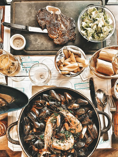 On the table food cooking kitchen vegetables foodie flat lay France foreign table mussels seafood steak meat wine cocktails French restaurant cafe café bread Paris salad Instagram influencer blogger photo