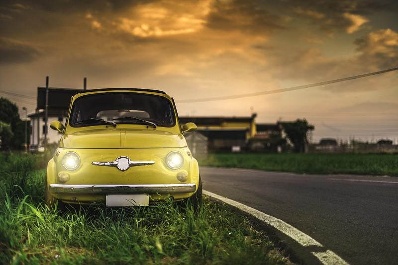 Small vintage italian car Fiat Abarth. Yellow color photo