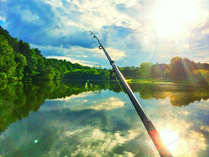 view of lake and fishing rod photo