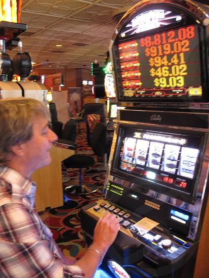 Las Vegas male gambling slots slot machines photo