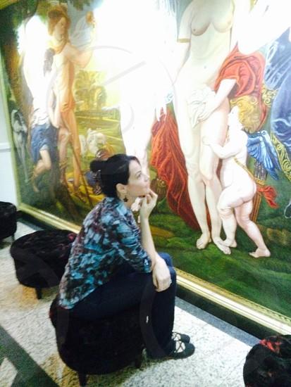 woman looking at wall painting photo