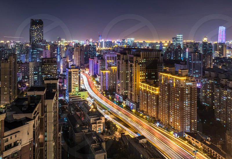 Light stream of the elevated city highway Yan An road in Shanghai at night skyscrapers city lights traffic photo