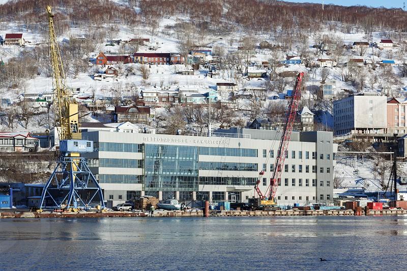 PETROPAVLOVSK-KAMCHATSKY CITY KAMCHATKA PENINSULA RUSSIA - DEC 31 2016: Winter view of new modern building of Marine Station in commercial sea port Petropavlovsk-Kamchatsky on Avacha Bay. photo