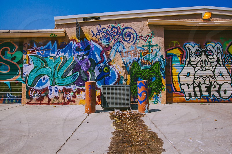 photo of wall graffiti during daytime photo
