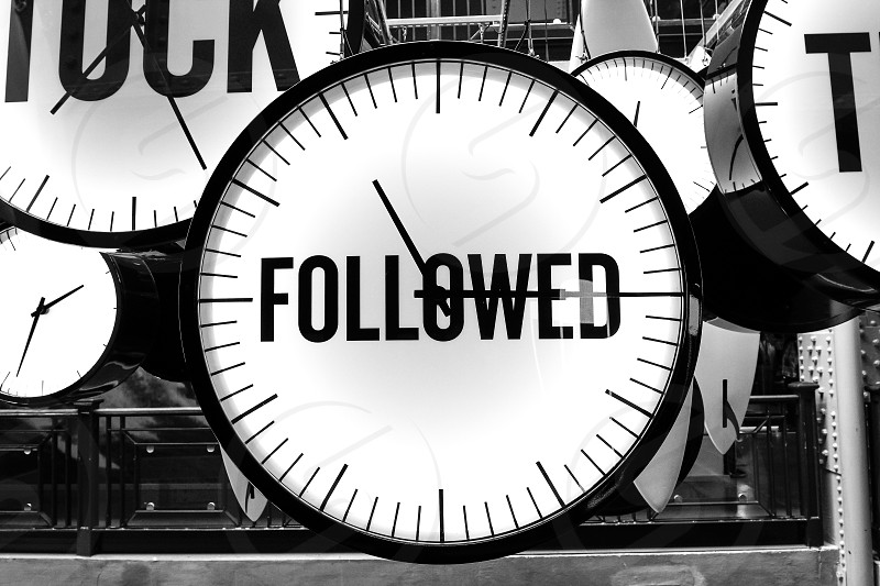 """black and white photos with a large clock with the inscription """"FOLLOWED"""" photo"""