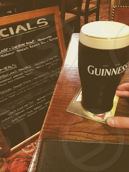 A nice pint of Guinness along with a delightful yet huge board of specials.  photo