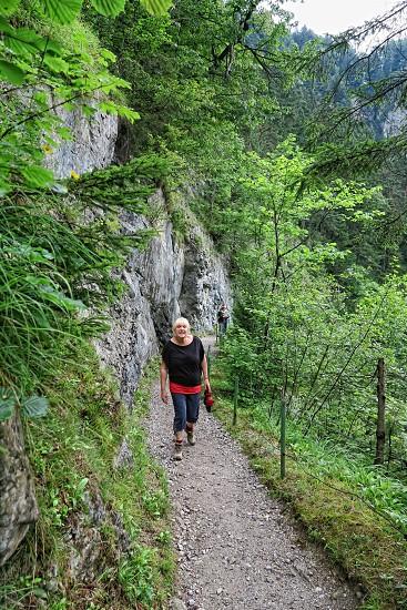 Stans Tirol/ AUSTRIA July 25 2016: people hiking through Wolfsklamm gorge canyon near Stans in Tirol Austria. Karwendel mountain alps. photo