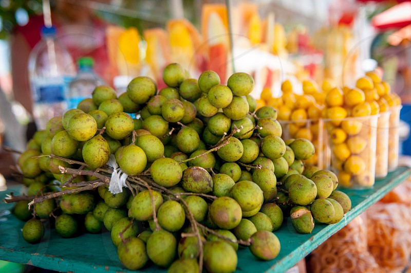 bundles of green round small fruit photo