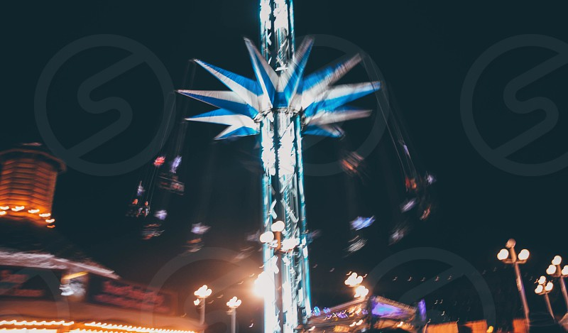 blue lighted carnival swing during nighttime photo