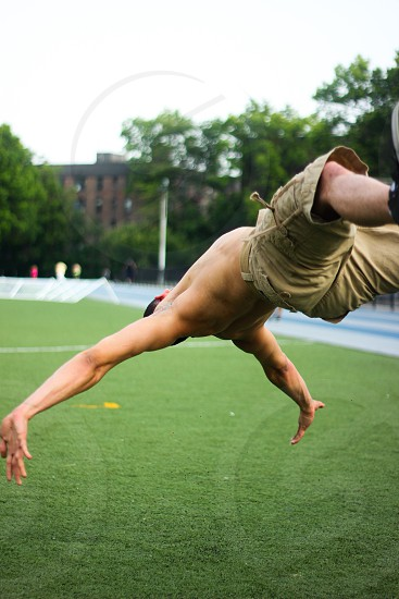Athletic male in New York City dances for the camera photo