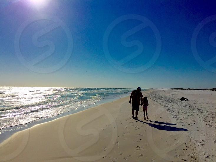 beach vacation dad daughter Florida sunshine shoreline beach walk photo