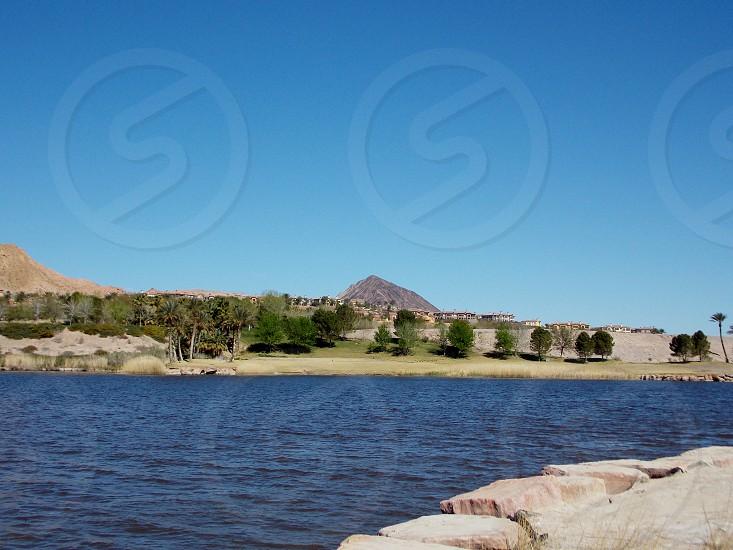 Rocks lake and mountain photo