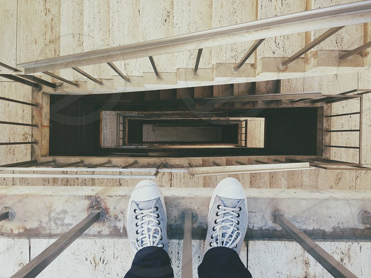 person standing near stairs low angle photography photo