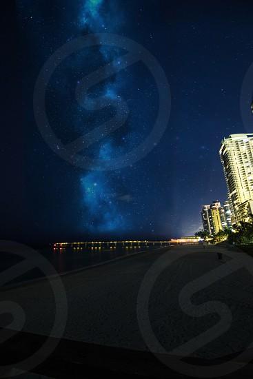 Sky night stars nature beach pier ocean outdoors buildings architecture seascape Milky Way  photo