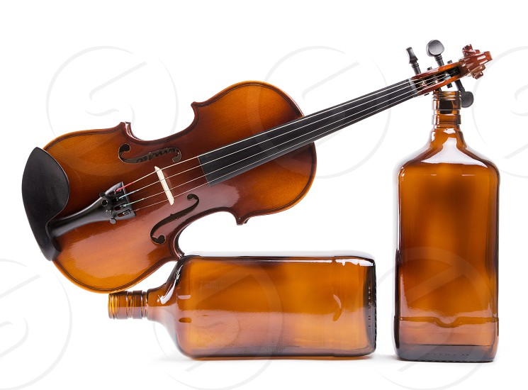Still life with violin and glass bottles photo