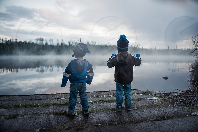 youth children sensory fog mist lake cool evening foggy clouds cloudy boat launch brothers hats cold wonder explore view p.o.v. imagination photo