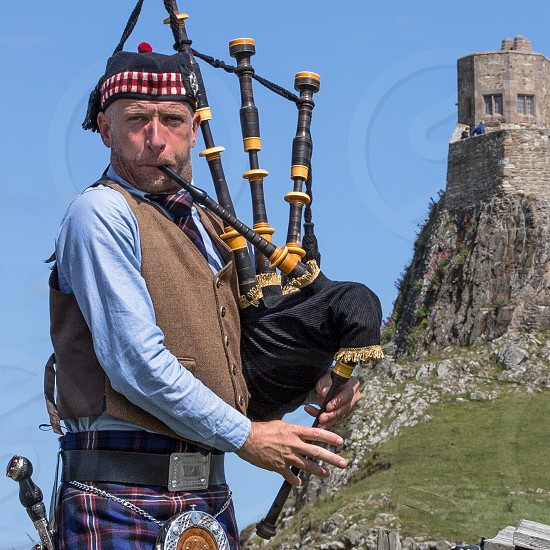 Man playing bagpipes in Scotland. photo