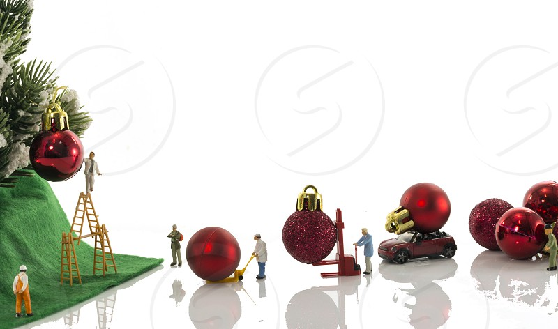 little world miniatures decorating the christmas tree with red balls photo