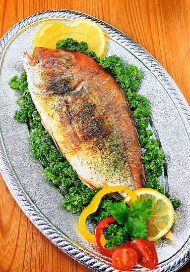 Cooked Whole white fish-nature wood background photo