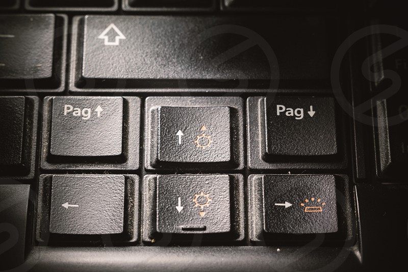 Close-up view of old and dirty black keyboard buttons.  photo