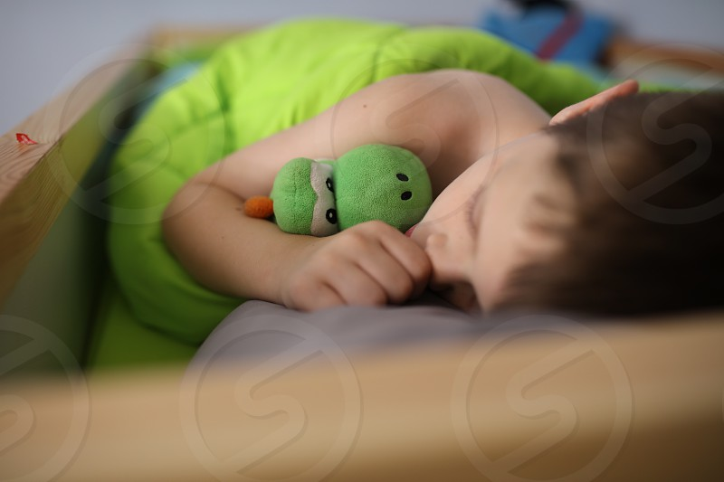 Sleeping boy resting  photo