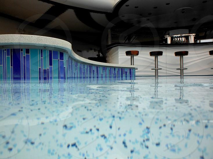 Swimming pool edge with bar photo