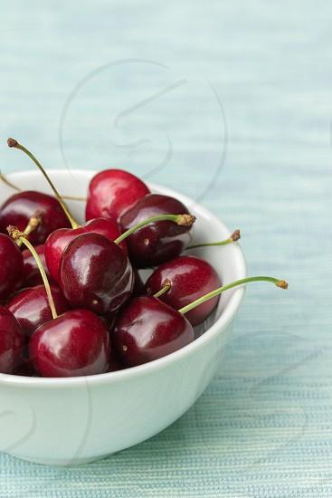 A bowl of ripe cherries photo
