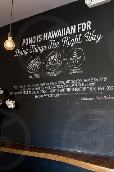 black board with pono is hawaiian for doing things the right way text photo