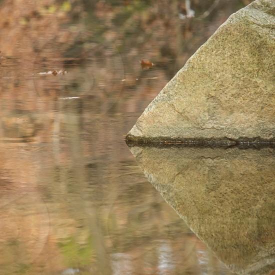 Reflection. Stream. Rock. Triangle. Shape. Pyramid. Abstract. Balance. Symmetry.  photo