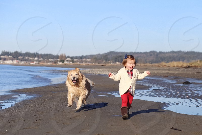 Happy jog on the beach on a cold Winter day.  photo