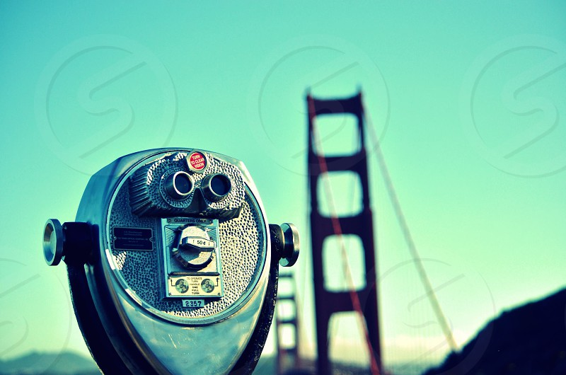 silver telescope with Golden Gate Bridge background photo
