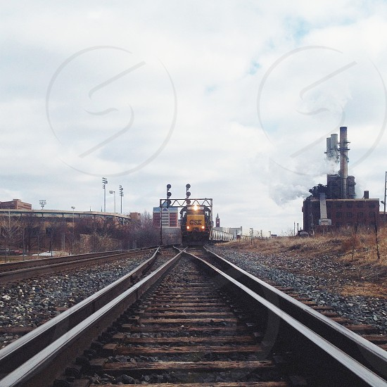 view of a train coming from a rail track  photo